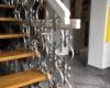 Qualitätive Lackierung eines Treppengeländers